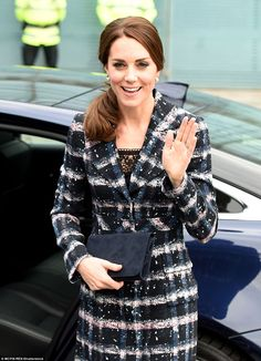 Kate gives a cheerful wave to the crowds who were lining the streets to get a glimpse of the royal visitor
