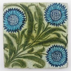 A William De Morgan tile painted with three blue - by Woolley & Wallis