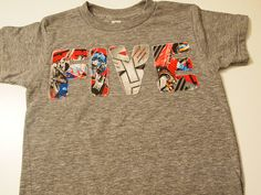 Maybe each letter could be a diff super hero? Transformers Birthday Tee Boys Birthday Shirt organic blend Star Wars fabric also available. $28.00, via Etsy.