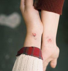 Matching initials (SC) + flower tattoo on the wrists. Tattoo artist: Sol Tattoo