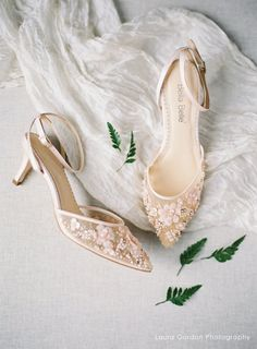 - Rosa Blush - Euphoria collection - Featuring 3D floral beading and scattering pearls - Laser-cut chiffon and pearlized petals - Comfortable kitten heel with ankle strap for secure fitting - Blush - 2 1/2 inch heel - Handmade and handbeaded - Imported silk - Imported leather sole - Heavy padding for all-day comfort