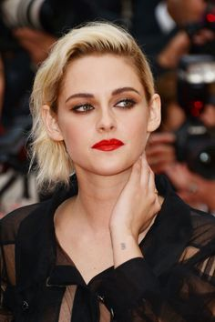 Kristen Stewart pairs a red lip and smudgy eyeliner for a gorgeous glam rock look at Cannes. Source: Getty Images