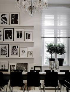 black and white dining room...tres chic! The  overhead antique chandelier is the perfect jewelry and counterpoint to this dining room.