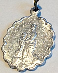 "Vintage Our Lady of Victory Miraculous Medal Virgin Mary Jesus (Image1) Size: 1.25"" including bail Color: Silver aluminum Type: Holy Medal, religious, charm, pendant, Mens,Ladies Religious, Vintage, Catholic, Christian  Scalloped holy medal featuring the Blessed Mother, Virgin Mary as Our Lady of Victory. The reverse features the traditional symbols of the Miraculous medal."
