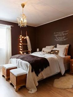 An old ladder is used as a decor accessory in this warm bedroom #chocolate #brown