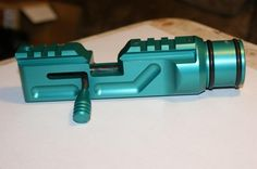 "Crosmods right hand breech anodized green, with matching ""sniper"" bolt handle"