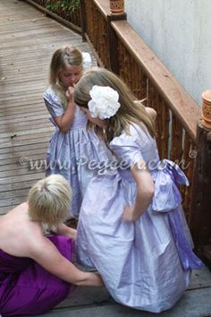 Lilac and lavender flower girl dresses by Pegeen.com
