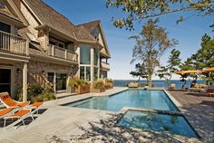 DHD Architecture + Interior Design Hamptons House Exterior - Renovation + Pool + Outdoor Furniture with Orange Lounge Chairs