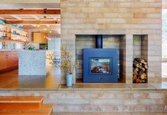 """The  rammed earth Watershed Blocks  for this sustainable private residence by Arkin Tilt architects were manufactured using a combination of two different regionally sourced aggregates. Varying the ratio between the two in the formulation resulted in the """"random mottling"""" that gives the walls their natural appearance. The architects wisely use the block to encase the wood stove to serve as a heat sink - a thermal flywheel. Oak from the surrounding forest yields its stored CO2 to warm both…"""