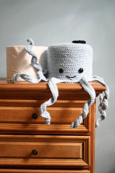 You want to keep an extra roll nearby just in case, but prefer to keep it classy at the same time. Try a cute crochet octopus to conceal your TP!    He