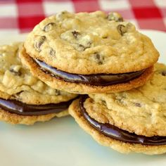 Coconut Chocolate Chip Sandwich Cookies - one of our lunch box favorites; crispy chewy coconut chocolate chip cookies sandwiched together with luscious chocolate ganache filling. Sandwich Cookies, Just Desserts, Delicious Desserts, Yummy Food, Rock Recipes, Sweet Recipes, Brownies, Cookie Recipes, Sweets