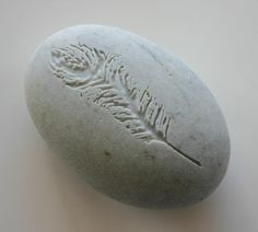 Hey, I found this really awesome Etsy listing at https://www.etsy.com/listing/156595266/feather-engraved-stone-angels-feather