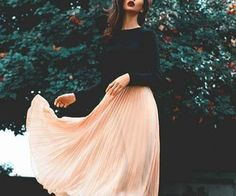 beautiful peach long skirt with black long sleeve blouse wine red lipstick