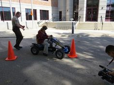 Participants drove a pedal car through a course set up while wearing drunk-simulation goggles at a community awareness opportunity held at the Administration Center in downtown St. Cloud.