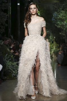 Beautiful ostric feather wedding dress witih a high front slit by Elie Saab Couture Spring Summer 2015 Paris - NOWFASHION