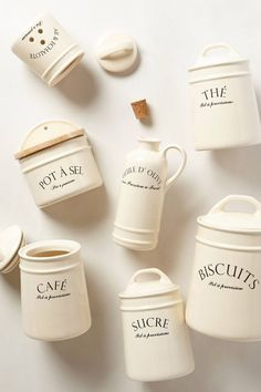 Bistro Canisters - anthropologie. they have coffee, tea, salt, olive oil, sugar, biscuits (which we could use as a flour jar). so cute :D