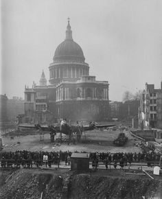 3rd March 1943: A Stirling bomber in front of St Paul's Cathedral in the City during 'Wings for Victory' week, in an area cleared of bombed buildings. (Photo by Davis/Topical Press Agency/Getty Images