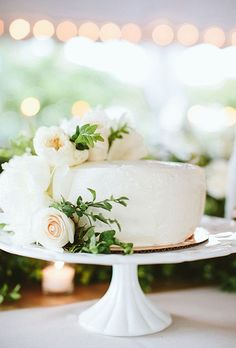 Brides.com: . A one-tier white wedding cake decorated with cascading flowers, created by Harris Teeter.