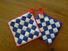 KarinV's Delftware potholders - a *great* project to practice or become familiar with the entrelac technique. I really like this pattern because the crocheter gives directions for adding the little triangles to make the edges straight. Red trim with tiny hearts are a cute touch. . . . . ღTrish W ~ http://www.pinterest.com/trishw/ . . . . #crochet
