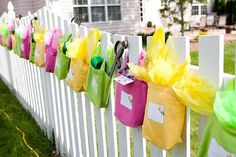 cute idea to hang the party favors along the fence-- kids will definitely remember to bring them home!!