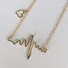 ❗️2 LEFT❗️Heartbeat Lifeline Necklace  ❗️AVAILABLE❗️Brand new • Available in only gold • $5, PRICE IS FIRM • Not real gold or silver (Zinc Alloy metal) Jewelry Necklaces