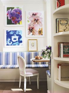 Designer Philip Gorrivan upholstered the breakfast-area banquette of Manhattan-based filmmaker Nathaniel Kramer's Upper East Side apartment in a cheery blue-and-white DeLany & Long awning stripe. Photographs by Kramer and an artist's proof by Joan Miro adorn the walls.
