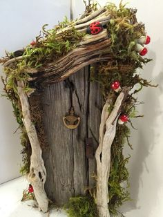 Rustic Miniature Fairy or Gnome Door.made with driftwood and embellishments! - Garden Style - Rustic Miniature Fairy or Gnome Door.made with driftwood and e Fairy Tree Houses, Fairy Garden Houses, Garden Gnomes, Fairy Gardening, Flower Gardening, Fairy Crafts, Garden Crafts, Garden Ideas, Garden Inspiration