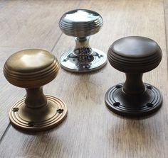 Choose a different finish to suit the style, era and décor of your home. Three reeded door knobs from British Ironmongery, shown in three different finishes: aged brass, antique brass and polished nickel. These door knobs are available in over twenty finishes and metals, including real, sand cast bronze. Each door knob is made in the UK and individually finished by hand. Available from - http://www.britishironmongery.co.uk/shop/reeded-cushion-door-knob/832.htm