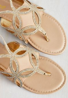 Bubbly aperitifs are no match for the effervescence of these light tan sandals - but, having both really makes the island vibes abound! As you sip, you'll be sparkling in more ways than one, thanks to this vegan faux-leather pair's gold slingbacks, iridescent rhinestones, and petal-like cutouts. Cheers!