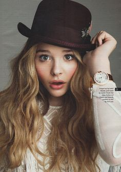 i adore everything about this, the hat, watch, hair color.