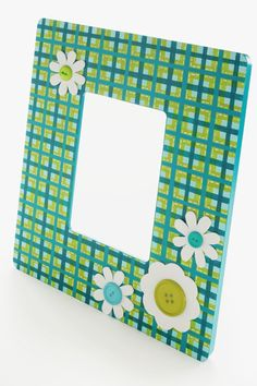 MOPS craft idea. Use gift wrap??        Plaid Daisy Frame #PlaidCrafts #crafts  Think about this with your kids picture in the  flower garden