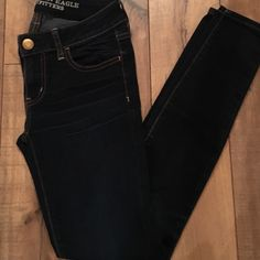 Dark Wash Skinny Jeans General use. Small nick of fabric on back waistband. Great condition. American Eagle Outfitters Pants Skinny