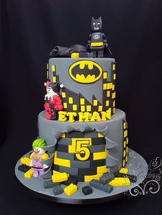 Batman Lego - Batman Party - Ideas of Batman Party - Batman Lego themed Layered black and yellow cake inside Hand molded Batman. Joker from chocolate modelling paste. Lego Batman Birthday Cake, Cake Lego, Lego Batman Cakes, Bolo Lego, Lego Batman Party, Lego Birthday Party, 5th Birthday, Lego Superhero Cake, Birthday Cake Models
