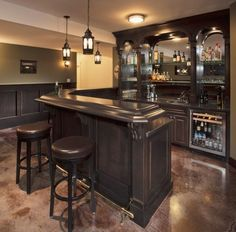 Bar with dark wood... Or painted black... Humm this would look good with our granite tops!