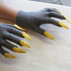 Spooky and fun, these gloves will make a statement any day, and are especially fitting around Halloween. The yellow claws look bright against the charcoal gray of the gloves. I made each claw from bright yellow knit fabric, backed with sturdy felt for shape retention, and then hand-stitched them