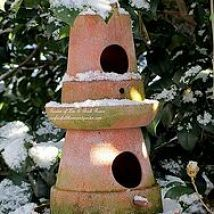 Double decker birdhouse...Ask in the hardware store for glue that will hold pots together for exterior use & wet down the clay pot to before drilling or cutting! (Garden of Len & Barb Rosen)