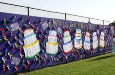 I want to do this at my local Relay. A wall of birthday cakes and ribbons.