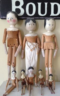 group of wooden dolls