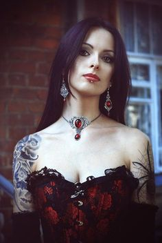It looks even better in Colour. Beautiful corset and jewellery.
