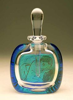 """Eternal""    Art Glass Perfume Bottle    Created byDavid New-Small        Blown glass perfume bottle. Drawings are engraved by hand on blue-green dichroic glass and melted into the clear glass body. An excerpt from a classic love poem or sonnet appears on the back. Part of the artist's ""Love Songs"" series.   See additional image for example of the reverse view. The poem quoted may be different from the one shown."
