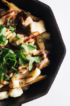 Peking duck poutine: crispy french fries, squeaky cheese curds, juicy duck, green onions and cilantro smothered in savory duck gravy. Poutine Recipe, Fries Recipe, Crispy French Fries, Peking Duck, Cheese Curds, Cast Iron Recipes, Asian, Food 52, Weeknight Meals