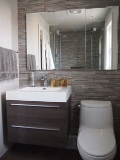 Grey horizontal mosaic-like tiles behind basic, side painted white