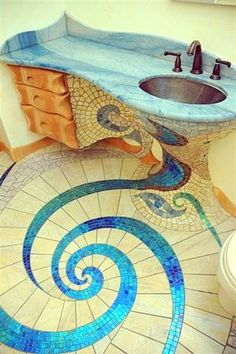 Mosaic floor & sink, love the design!  Hope there's an access panel on the other wall for the plumbing, though.