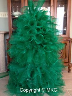 Green mesh Christmas tree that I made for my MIL with lights.