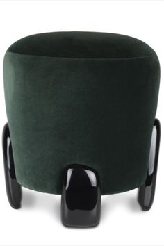 The monolithic statues of Easter Islands, known for Moai or Naoki, were the inspiration behind NOAKI Stool. With a seating in velvet and a base in glossy black lacquer, this distinct contemporary stool is perfect to use as a table stool, living room stool or as a footstool.  #livingroomdesign #contemporarylivingrooms #modernlivingrooms #classiclivingrooms #mid-centurylivingrooms #eclecticlivingrooms