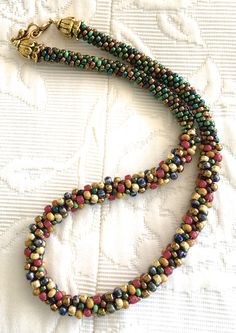 Picasso Multicolor Kumihimo Necklace by SixSistersCrafts on Etsy https://www.etsy.com/listing/494020330/picasso-multicolor-kumihimo-necklace
