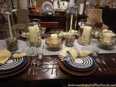 Blue and White Tablescape Love the rocks in clear glass with a blue ticking runner