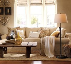 Corner 'sectional' sofa - cushions all different (various shapes, sizes, plain, patterned & monogrammed) but toning.