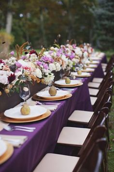 Gorgeous purple and gold table decorations.