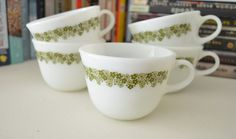"""Vintage Pyrex Spring Blossom Cups Set of 5 by PickledFurniture, $10.00.  This is a pretty set of five vintage Spring Blossom/Crazy Daisy Pyrex coffee or tea cups. They measure 2 3/4"""" tall x 4"""" across and holds 1 cup or 8 ounces."""